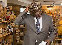 PQ MNA Maka Kotto puts on a fur hat while visiting a first nation store in Wendake, just North of Quebec City, June 3, 2015.