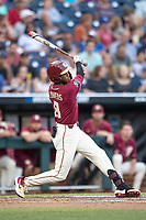 Florida State Seminoles outfielder JC Flowers (8) follows through on his swing during Game 9 of the NCAA College World Series against the Texas Tech Red Raiders on June 19, 2019 at TD Ameritrade Park in Omaha, Nebraska. Texas Tech defeated Florida State State 4-1. (Andrew Woolley/Four Seam Images)