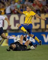 Sweden forward Sara Linden (8) vaults over sliding US goalkeeper Hope Solo (1). The US Women's national team beat Sweden, 3-0, at Rentschler Field on July 17, 2010.