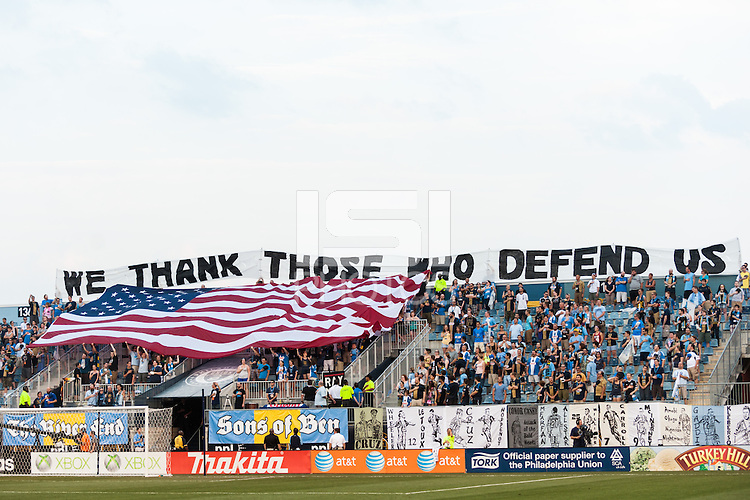 Philadelphia Union fans during the playing of the national anthem during a Major League Soccer (MLS) match at PPL Park in Chester, PA, on July 20, 2013.