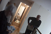 Pictured: John Barry Hargreaves in his house while Trading Standards are searching for evidence<br /> Re: Rogue traders Matthew Hargreaves, John Barry Hargreaves and Jean Hargreaves are due to be sentenced at Merthyr Tydfil Crown Court (Friday 16 September 2016) for selling a teeth whitening product with harmful levels of hydrogen peroxide, 110 times the legal limit, after a three year nationwide investigation by Powys County Council's Trading Standards Service culminated in guilty pleas being entered by three Manchester based rogue traders. <br /> Charges relating to Fraud and Consumer Protection offences were pursued relating to the sale of unsafe teeth whitening products across the UK.