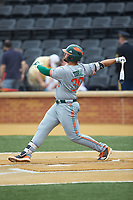 Alex Toral (30) of the Miami Hurricanes follows through on his swing against the Wake Forest Demon Deacons at David F. Couch Ballpark on May 11, 2019 in  Winston-Salem, North Carolina. The Hurricanes defeated the Demon Deacons 8-4. (Brian Westerholt/Four Seam Images)