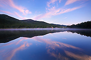 Crawford Notch State Park - Reflection of mountain range in Saco Lake during the summer months in the White Mountains, New Hampshire at sunrise.