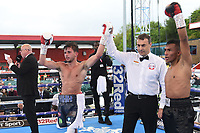 Harvey Horn (blue/white shorts) defeats Joel Sanchez during a Boxing Show at Stevenage Football Club on 18th May 2019