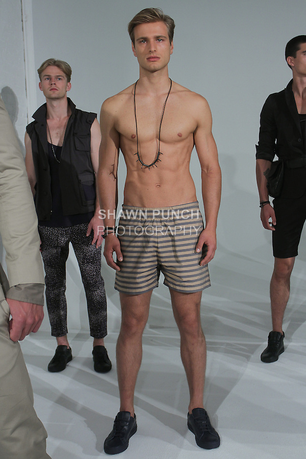 """Model poses in an outfit from the Cadet Spring Summer 2016 """"The Filthy 13"""" collection by Raul Arevalo and Brad Schmidt, at New York Men's Day, during New York Fashion Week Men Spring Summer 2016."""