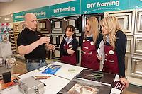 Artist Gary Davies explains some art techniques to Hobbycraft's Chris, Di and Jessica