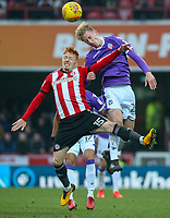 Bolton Wanderers' Harry Charsley battles with Brentford's Ryan Woods<br /> <br /> Photographer Alex Dodd/CameraSport<br /> <br /> The EFL Sky Bet Championship - Brentford v Bolton Wanderers - Saturday 13th January 2018 - Griffin Park - Brentford<br /> <br /> World Copyright &copy; 2018 CameraSport. All rights reserved. 43 Linden Ave. Countesthorpe. Leicester. England. LE8 5PG - Tel: +44 (0) 116 277 4147 - admin@camerasport.com - www.camerasport.com