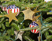 """Close-up of some of the ornaments and tributes on the Christmas tree that adorns the East Landing as part of the 2015 White House Christmas theme """"A Timeless Tradition"""" at the White House in Washington, DC on Wednesday, December 2, 2015.<br /> Credit: Ron Sachs / CNP"""