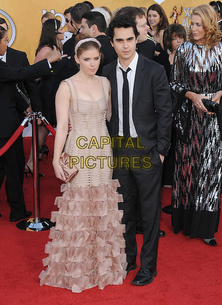 KATE MARA & MAX MINGHELLA.17th Annual Screen Actors Guild Awards held at The Shrine Auditorium, Los Angeles, California, USA..January 30th, 2011.SAG arrivals full length beige pink ruffle fishtail dress sleeveless hairband black suit white shirt couple clutch bag.CAP/RKE/DVS.©DVS/RockinExposures/Capital Pictures.