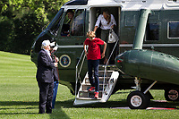 United States President Donald J. Trump, Barron Trump, and First Lady Melania Trump exit  Marine One after arriving at The White House on June 18, 2017 in Washington, D.C. President Trump spent the weekend at Camp David.<br /> Credit: Zach Gibson / Pool via CNP /MediaPunch