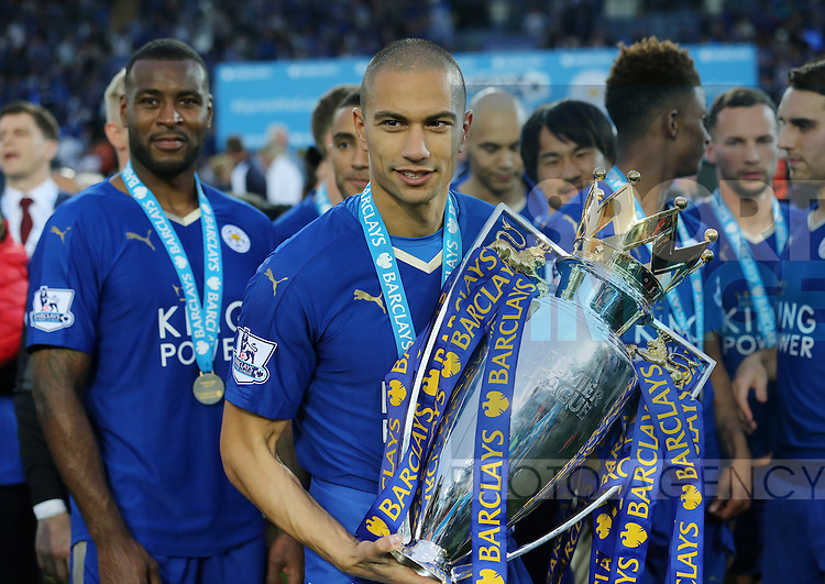 Leicester's Gokhan Inler celebrates with the trophy during the Barclays Premier League match at the King Power Stadium.  Photo credit should read: David Klein/Sportimage