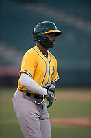 AZL Athletics left fielder Lawrence Butler (23) jogs to first base after drawing a walk during an Arizona League game against the AZL Angels at Tempe Diablo Stadium on June 26, 2018 in Tempe, Arizona. The AZL Athletics defeated the AZL Angels 7-1. (Zachary Lucy/Four Seam Images)