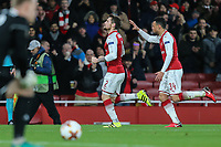 Mathieu Debuchy of Arsenal (2nd right) celebrates after he scores the opening goal of the game during the UEFA Europa League match between Arsenal and FC BATE Borisov  at the Emirates Stadium, London, England on 7 December 2017. Photo by David Horn.