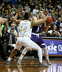 SIOUX FALLS, SD: Mack Johnson #3 from the University of Sioux Falls looks past the defense of KJ Davis #14 from Southwest Minnesota State in the first half of their NSIC Tournament game Sunday at the Sanford Pentagon (Photo by Dave Eggen/Inertia)