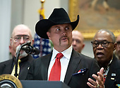 "John Rich of Big & Rich makes short remarks after United States President Donald J. Trump signed H.R. 1551, the ""Orrin G. Hatch-Bob Goodlatte Music Modernization Act"" in the Roosevelt Room of the White House in Washington, DC on Thursday, October 11, 2018.<br /> Credit: Ron Sachs / CNP"