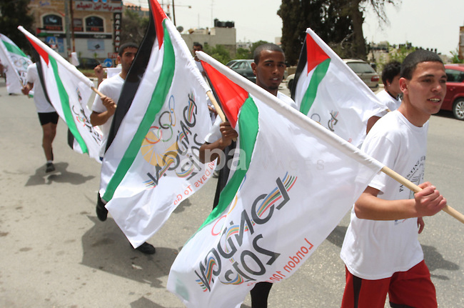 Palestinian athletes ran in the Olympic Marathon  (100 days before the start of the London Olympics 2012) in the West Bank city of Ramallah April 18, 2012. Photo by Issam Rimawi