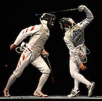 Un colpo vincente di Salvatore Sanzo nella finale per la medaglia di bronzo contro il cinese Jun Zhu.Fencing Hall - Scherma Fioretto Maschile - Men's Epee.Pechino - Beijing 13/8/2008 Olimpiadi 2008 Olympic Games.Foto Andrea Staccioli Insidefoto