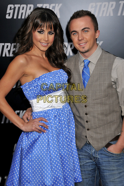 "ELYCIA TURNBOW & FRANKIE MUNIZ.""Star Trek"" Los Angeles Premiere held at Grauman's Chinese Theatre, Hollywood, CA, USA..April 30th, 2009.half length blue strapless dress white sash hand on hip grey gray waistcoat couple polka dot .CAP/ADM/BP.©Byron Purvis/AdMedia/Capital Pictures."
