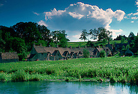 Arlington Row armshouses cottages in the famous tourist village of Bibury, in the Cotswolds, Gloucestershire, England