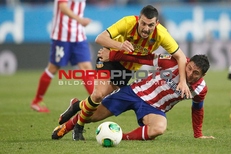 Atletico de Madrid¬¥s Cristian Rodriguez (R) and Saint Andreu¬¥s  during Copa del Rey 2013-14 match at Vicente Calderon Stadium in Madrid, Spain. Foto © nordphoto / Victor Blanco) *** Local Caption ***