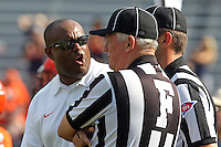 Virginia head coach Mike London argues with referees during the football game Saturday Oct. 5, 2013 at Scott Stadium in Charlottesville, VA. Ball State defeated Virginia 48-27. Photo/The Daily Progress/Andrew Shurtleff