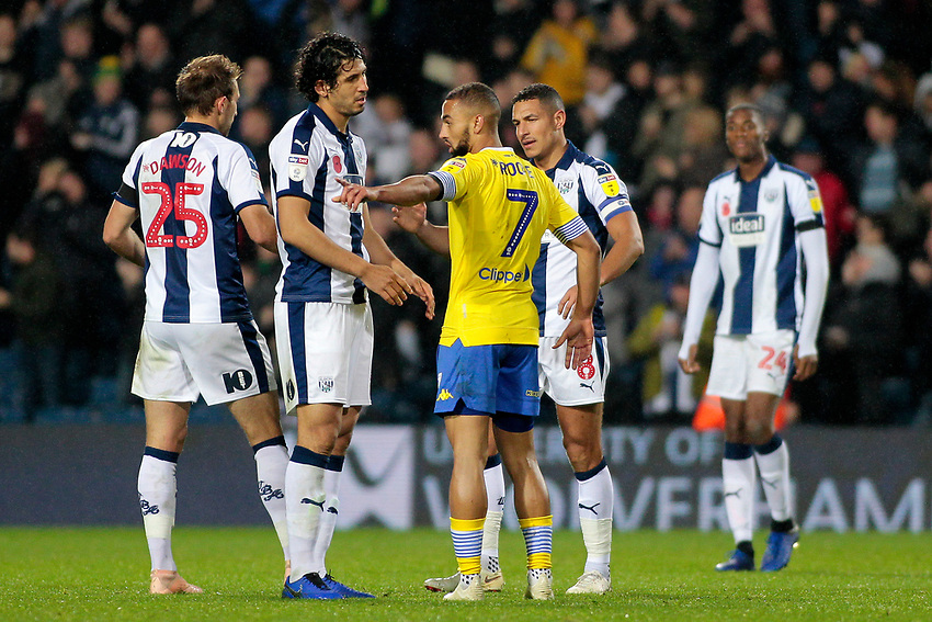 Leeds United's Kemar Roofe argues with West Bromwich Albion's Ahmed Hegazy after falling over in an attempt to win a penalty<br /> <br /> Photographer David Shipman/CameraSport<br /> <br /> The EFL Sky Bet Championship - West Bromwich Albion v Leeds United - Saturday 10th November 2018 - The Hawthorns - West Bromwich<br /> <br /> World Copyright © 2018 CameraSport. All rights reserved. 43 Linden Ave. Countesthorpe. Leicester. England. LE8 5PG - Tel: +44 (0) 116 277 4147 - admin@camerasport.com - www.camerasport.com