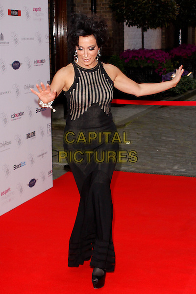 Nancy Dell'Olio.The FiFi UK Fragrance Awards 2012 arrivals, The Brewery, London, England, May 17th, 2012.full length black sleeveless dress striped stripes hands arms platform shoes gesture.CAP/AH.©Adam Houghton/Capital Pictures.