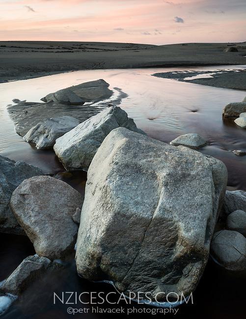 Dawn on beach with boulders in creek near Karamea, Kahurangi National Park, Buller Region, West Coast, New Zealand, NZ