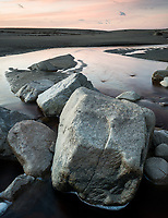 Dawn on beach with boulders in creek near Karamea, Kahurangi National Park, Buller Region, West Coast, New Zealand, NZ