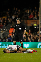 Aleksandar Mitrovic of Fulham FC is felled during the Sky Bet Championship match between Fulham and Sheff United at Craven Cottage, London, England on 6 March 2018. Photo by Carlton Myrie.