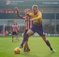 Lincoln City's Harry Anderson vies for possession with Mansfield Town's Neal Bishop<br /> <br /> Photographer Chris Vaughan/CameraSport<br /> <br /> The EFL Sky Bet League Two - Lincoln City v Mansfield Town - Saturday 24th November 2018 - Sincil Bank - Lincoln<br /> <br /> World Copyright &copy; 2018 CameraSport. All rights reserved. 43 Linden Ave. Countesthorpe. Leicester. England. LE8 5PG - Tel: +44 (0) 116 277 4147 - admin@camerasport.com - www.camerasport.com