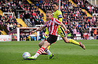Lincoln City's Danny Rowe under pressure from Cheltenham Town's Ben Tozer<br /> <br /> Photographer Chris Vaughan/CameraSport<br /> <br /> The EFL Sky Bet League Two - Lincoln City v Cheltenham Town - Saturday 13th April 2019 - Sincil Bank - Lincoln<br /> <br /> World Copyright © 2019 CameraSport. All rights reserved. 43 Linden Ave. Countesthorpe. Leicester. England. LE8 5PG - Tel: +44 (0) 116 277 4147 - admin@camerasport.com - www.camerasport.com