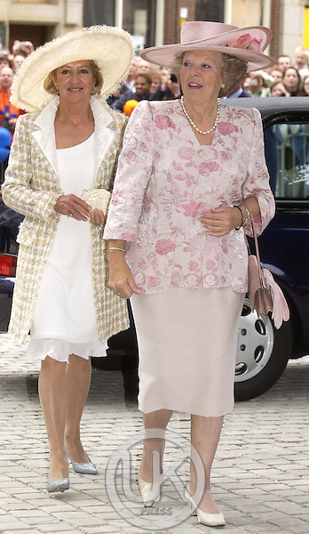 Queen Beatrix & Maria del Carmen Cerruti de Zorreguieta attend the Christening of Crown Prince Willem-Alexander & Crown Princess Maxima of Holland's daughter Catharina-Amalia at the St. Jacobskerk Church in The Hague..