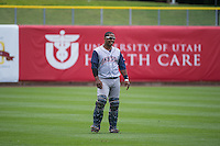 Robinson Diaz (7) of the Colorado Springs Sky Sox warms up in the outfield before the game against the Salt Lake Bees in Pacific Coast League action at Smith's Ballpark on May 24, 2015 in Salt Lake City, Utah.  (Stephen Smith/Four Seam Images)