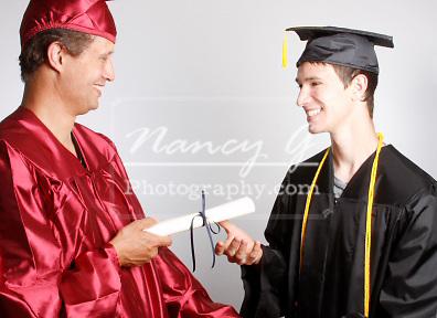 A Dean handing a graduate a diploma