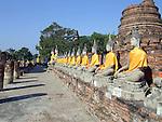 Row of Buddhas at the temple of Wat Yai Chai Mongkol in Ayutthaya near Bangkok, Thailand.