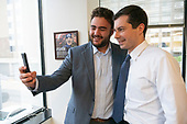 Mayor Pete Buttigieg takes a selfie with Harry Applestein during a communal parlor meeting at the offices of Bluelight Strategies in Washington D.C., U.S. on May 23, 2019.<br /> <br /> Credit: Stefani Reynolds / CNP