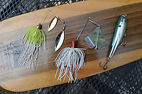 NWA Democrat-Gazette/FLIP PUTTHOFF <br /> Effective lures for summertime bass fishing at Lake Sequoyah include spinner baits (from left) buzz baits and top-water plugs. Best action is at dawn or dusk.