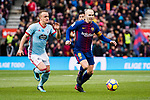 Andres Iniesta of FC Barcelona (R) competes for the ball with Stanislav Lobotka of RC Celta de Vigo (L) during the La Liga 2017-18 match between FC Barcelona and RC Celta de Vigo at Camp Nou Stadium on 02 December 2017 in Barcelona, Spain. Photo by Vicens Gimenez / Power Sport Images