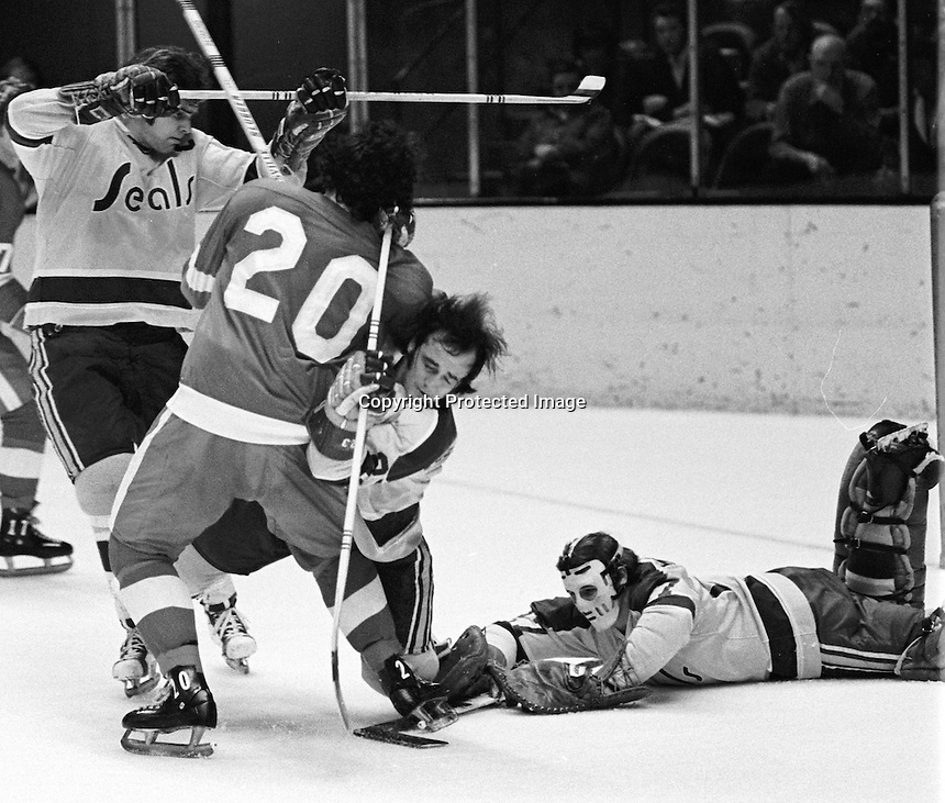 Seals action, Ted McAneeley on kneeling battles Mickey Redmond along with Bert Marshall and goalie Gilles Meloche.1972 (photo/Ron Riesterer)