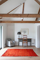 A-frame roof beams punctuate the ceiling of this converted bedroom