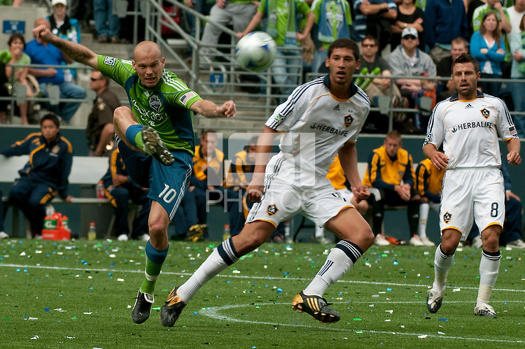 Freddie Ljungberg of the Seattle Sounders clears the ball against Omar Gonzalez and Dema Kovalenko of the LA Galaxy at Quest Field on May 10, 2009. The Sounders and Galaxy played to a 1-1 draw.