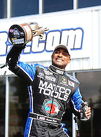 May 15, 2011; Commerce, GA, USA: NHRA top fuel dragster driver Antron Brown celebrates after winning the Southern Nationals at Atlanta Dragway. Mandatory Credit: Mark J. Rebilas-