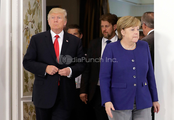 German Chancellor Angela Merkel greets US President Donald Trump ahead of the G20 Summit in the Hotel Atlantic in Hamburg, Germany, 06 July 2017. The G20 Summit of the heads of government and state takes place on 7 and 8 July 2017 in Hamburg. Photo: Matthias Schrader/Pool AP/dpa /MediaPunch ***FOR USA ONLY***