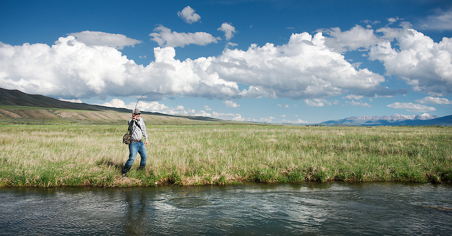 An angler fishes for rainbow trout on a spring creek south of Dillon, Montana.