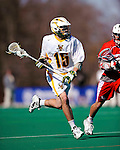 30 April 2011: University of Vermont Catamount attacker/midfielder Garrett Virtue, a Sophomore from Rye, NY, in action against the Stony Brook Seawolves at Moulton Winder Field in Burlington, Vermont. The Catamounts fell to the visiting Seawolves 12-9 to conclude their America East season. Mandatory Credit: Ed Wolfstein Photo