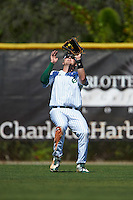 Eastern Michigan Eagles left fielder John Montgomery (44) gets under a fly ball that would drop in due to losing it in the sun during a game against the Dartmouth Big Green on February 25, 2017 at North Charlotte Regional Park in Port Charlotte, Florida.  Dartmouth defeated Eastern Michigan 8-4.  (Mike Janes/Four Seam Images)