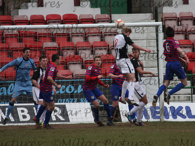 Blair Henderson (9) wins the aerial ball in the Dunfermline Athletic v St Mirren Scottish Football Association Youth Cup Semi Final match played at East End Park, Dunfermline on 24.3.13.