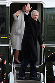 Washington, DC - January 20, 2009 -- Former UNited States President George W. Bush and former first lady Laura Bush wave before departing the U.S. Capitol by helicopter after the inauguration of Barack Obama as the 44th President of the United States of America on the West Front of the Capitol, Tuesday, January 20, 2009 in Washington, DC. Obama becomes the first African-American to be elected to the office of President in the history of the United States.  .Credit: John Moore / Pool via CNP
