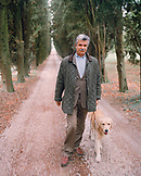 ITALY, Verona, Gargagnago di Valpolicella, portrait of Serego Alighieri walking with his dog in his estate La Foresteria Serego Alighieri.